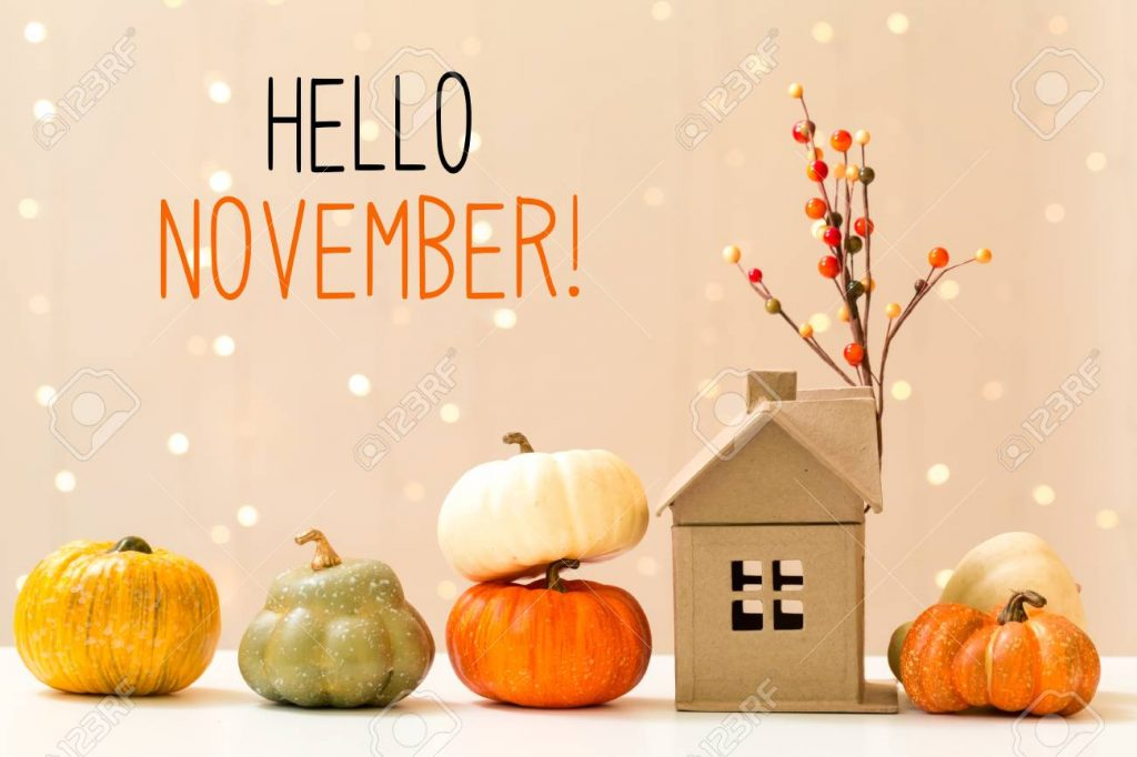 Hello November message with pumpkins with a house